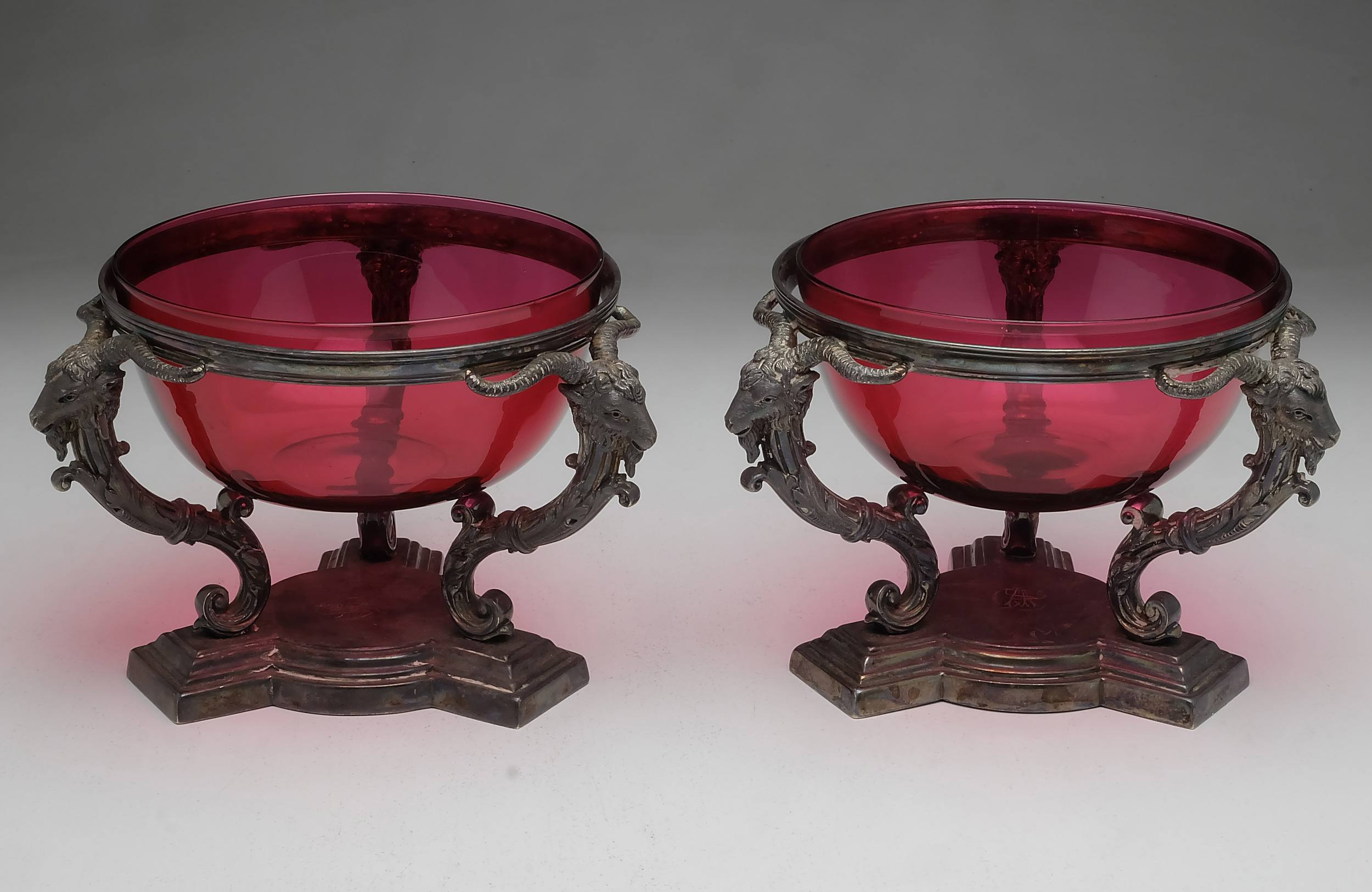 'Pair Victorian Crested and Monogrammed Electroplated and Ruby Glass Bonbonnieres With Ram Form Supports'