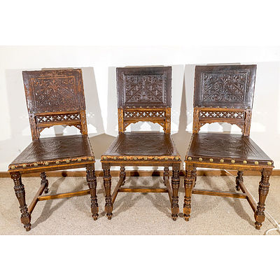 Six Late Victorian Walnut and Embossed Leather Dining Chairs with Tudor and Gothic Influence