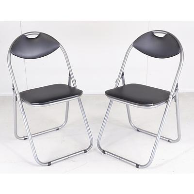 Seven Metal and Black Cushioned Collapsible Chairs