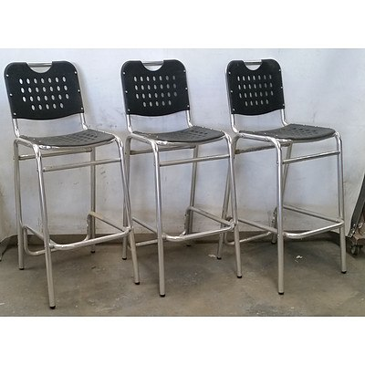 Seven Black and Chrome Bar Chairs