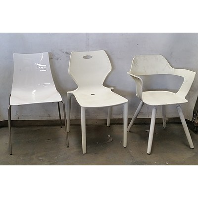 Group of Various White Chairs