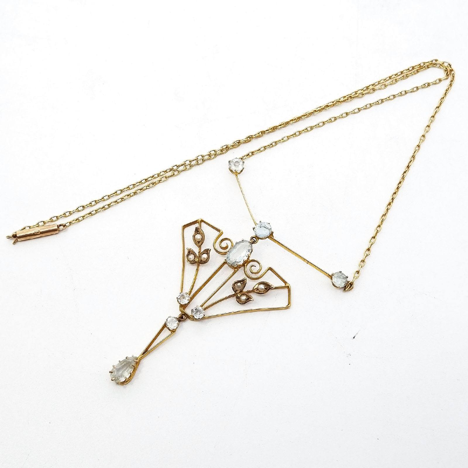 '9ct Yellow Gold Necklet with Centre Art Deco Pendant with Pale Blue Topaz and Half Seed Pearls in Claw Setting. 5.3g'