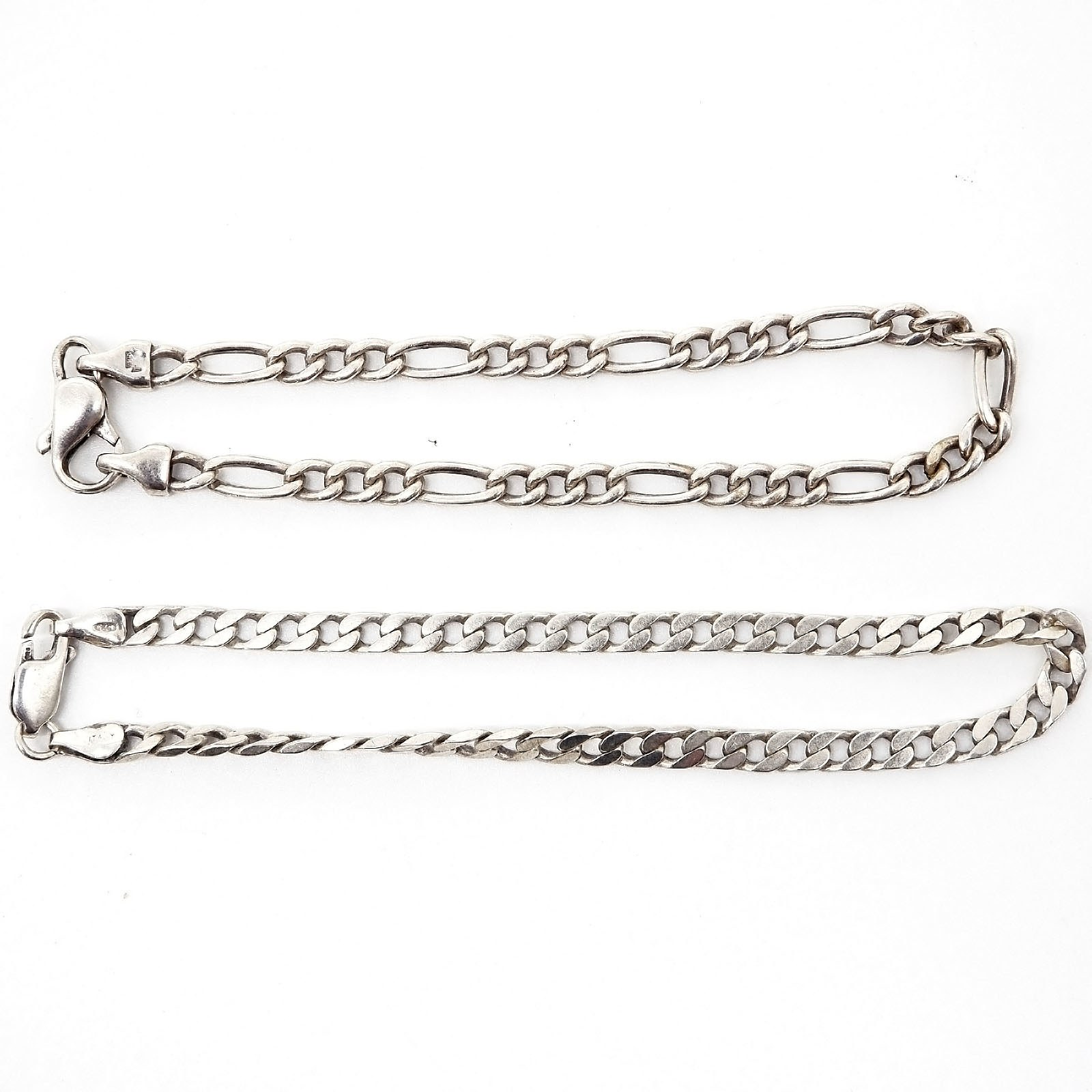 'Two Sterling Silver Curb Link Bracelets'