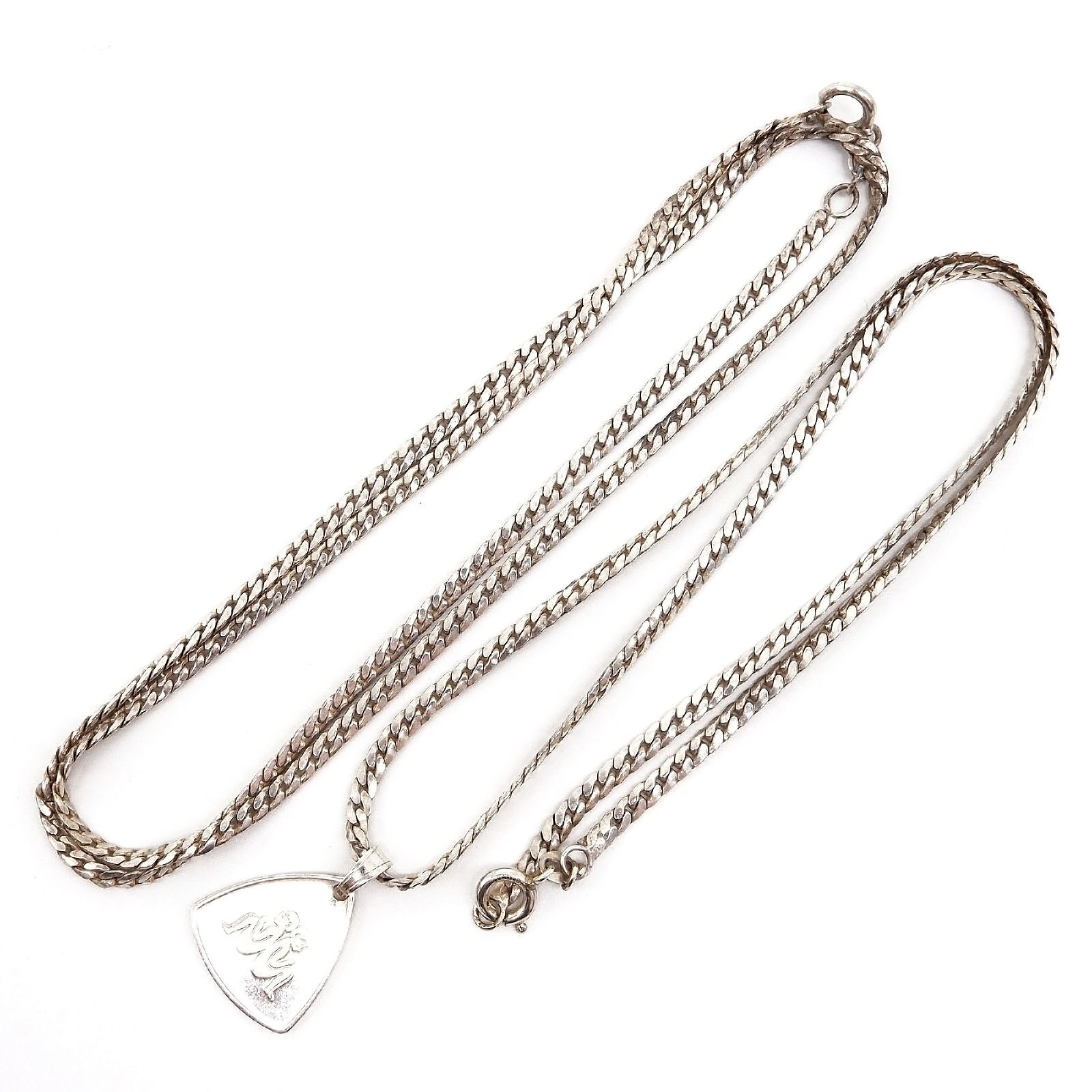 'Two Sterling Silver Filed Curb link Chains, One with a Pendant '