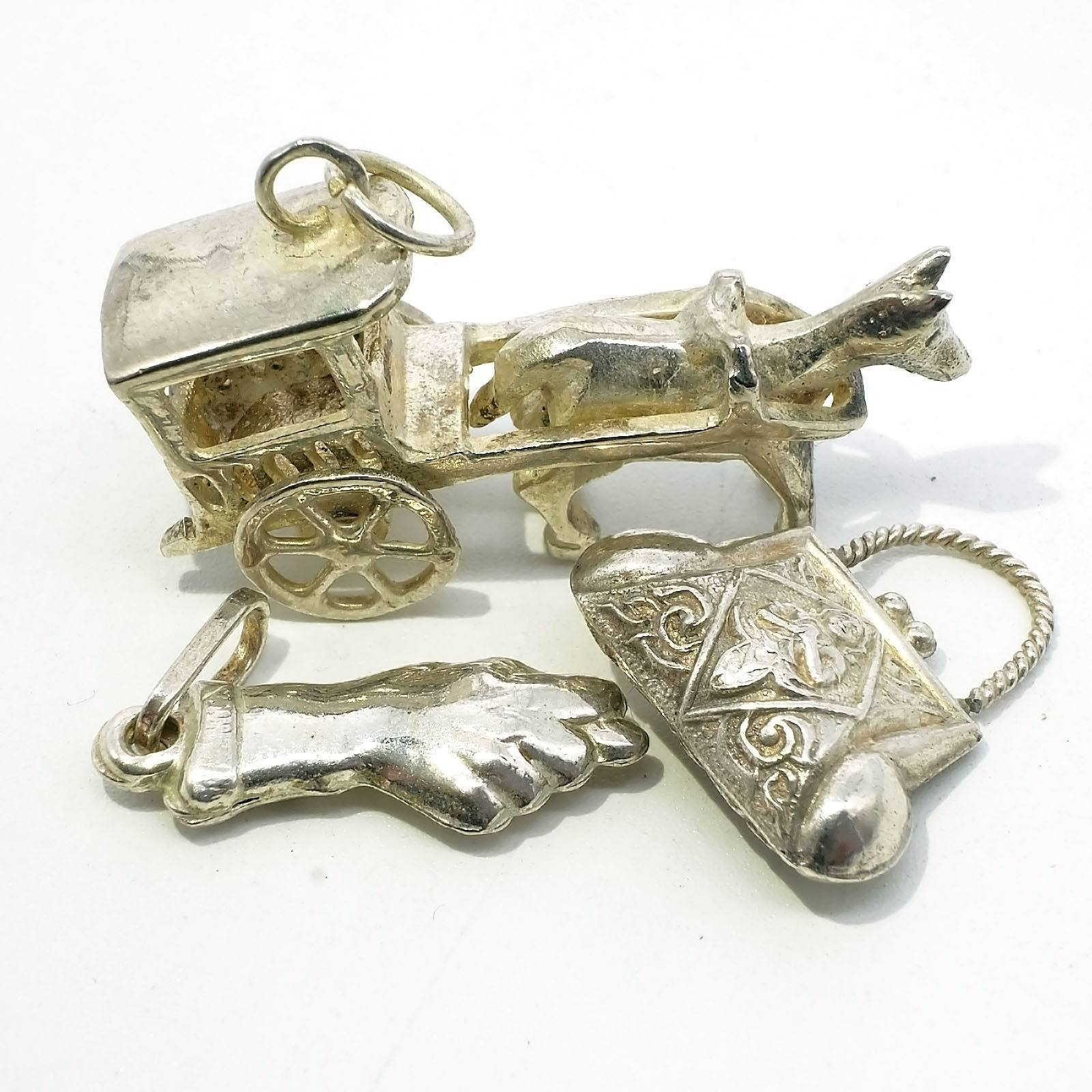 'Three Sterling Silver Charms'