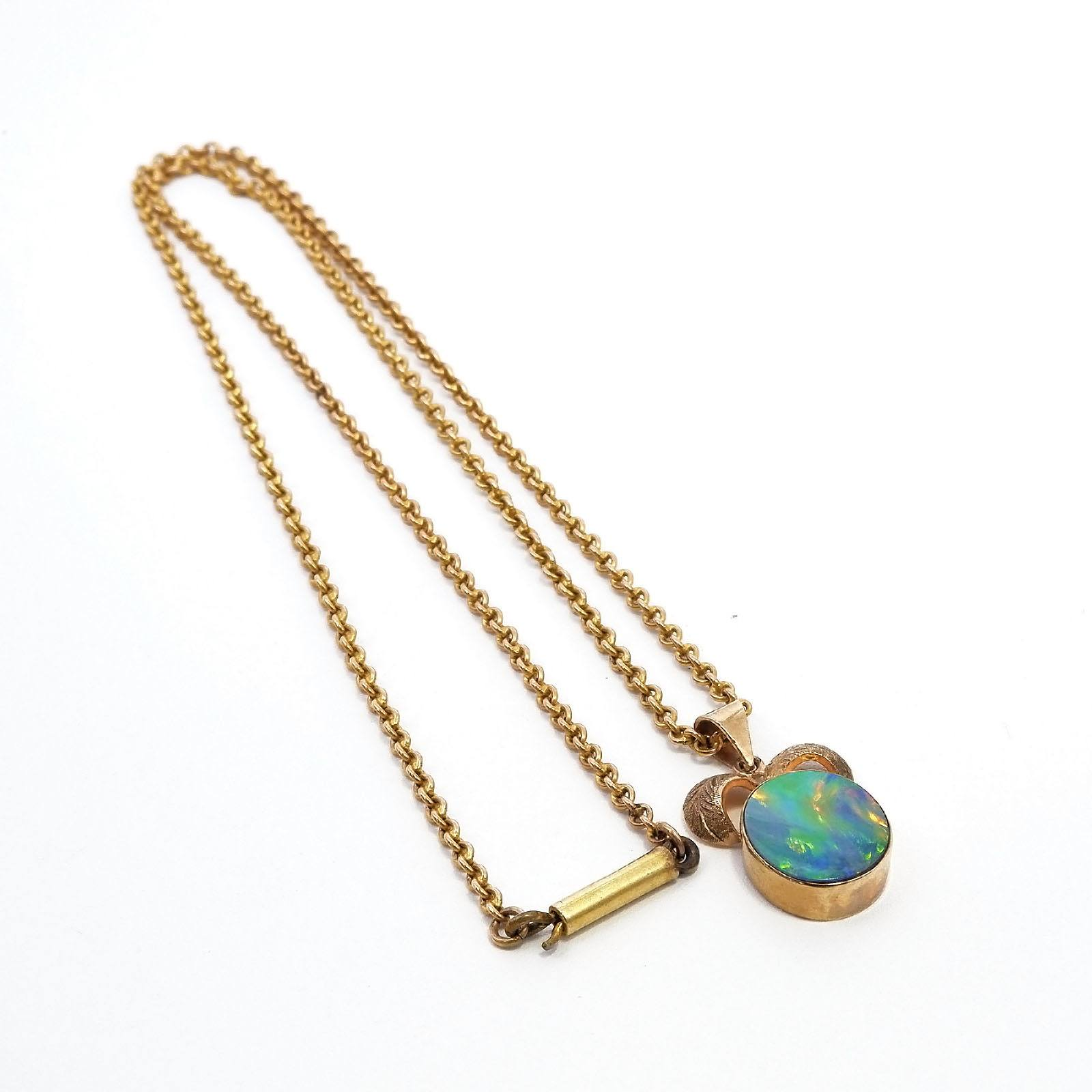'9ct Yellow Gold Pendant with Oval Opal Doublet in a Bezel Setting on a Curb Chain, 5.4g'