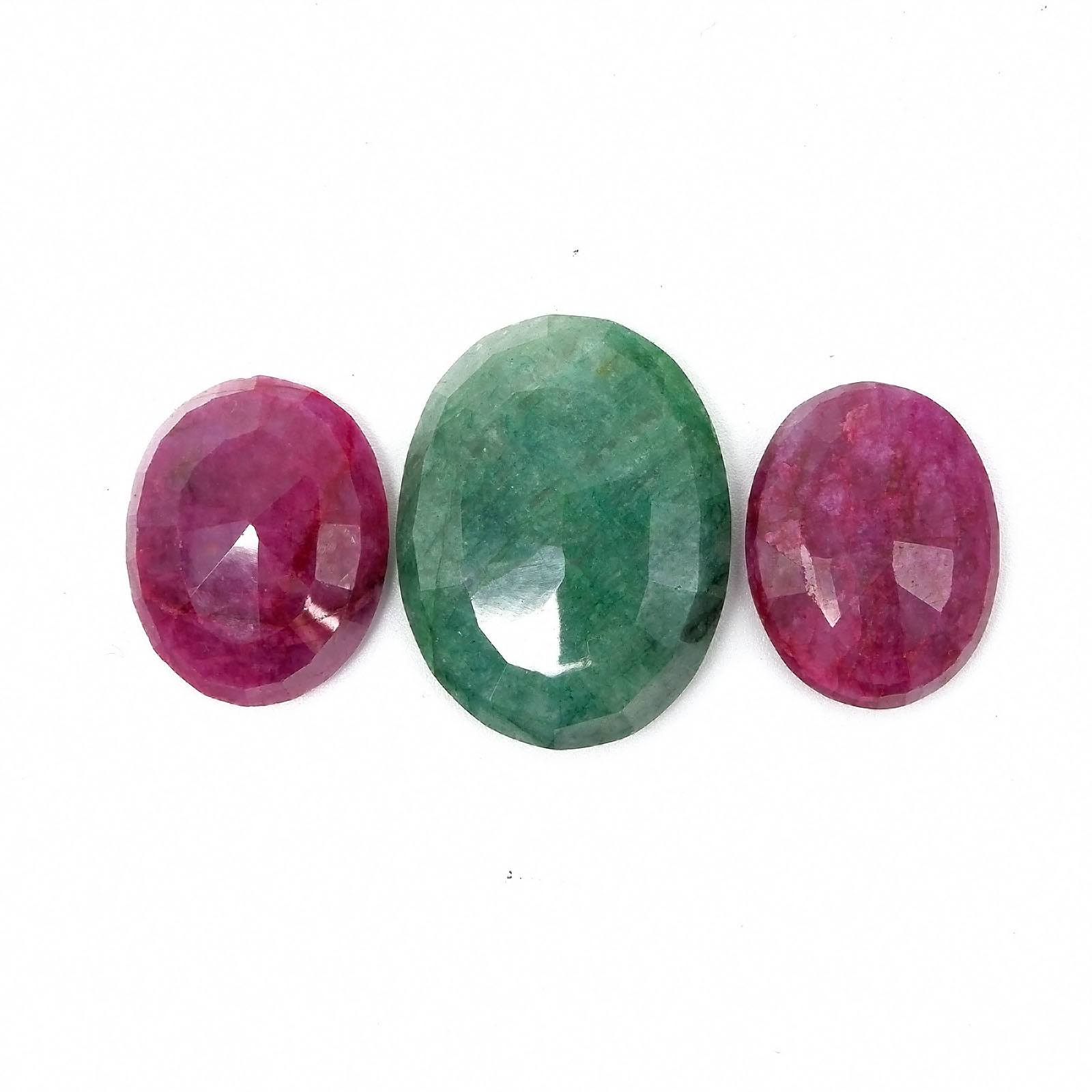 'Facetted Opaque Ruby 24.5 by 19.5mm, Facetted Opaque Ruby 19 by 18mm and Facetted Opaque Emerald 32 by 24.5cm'