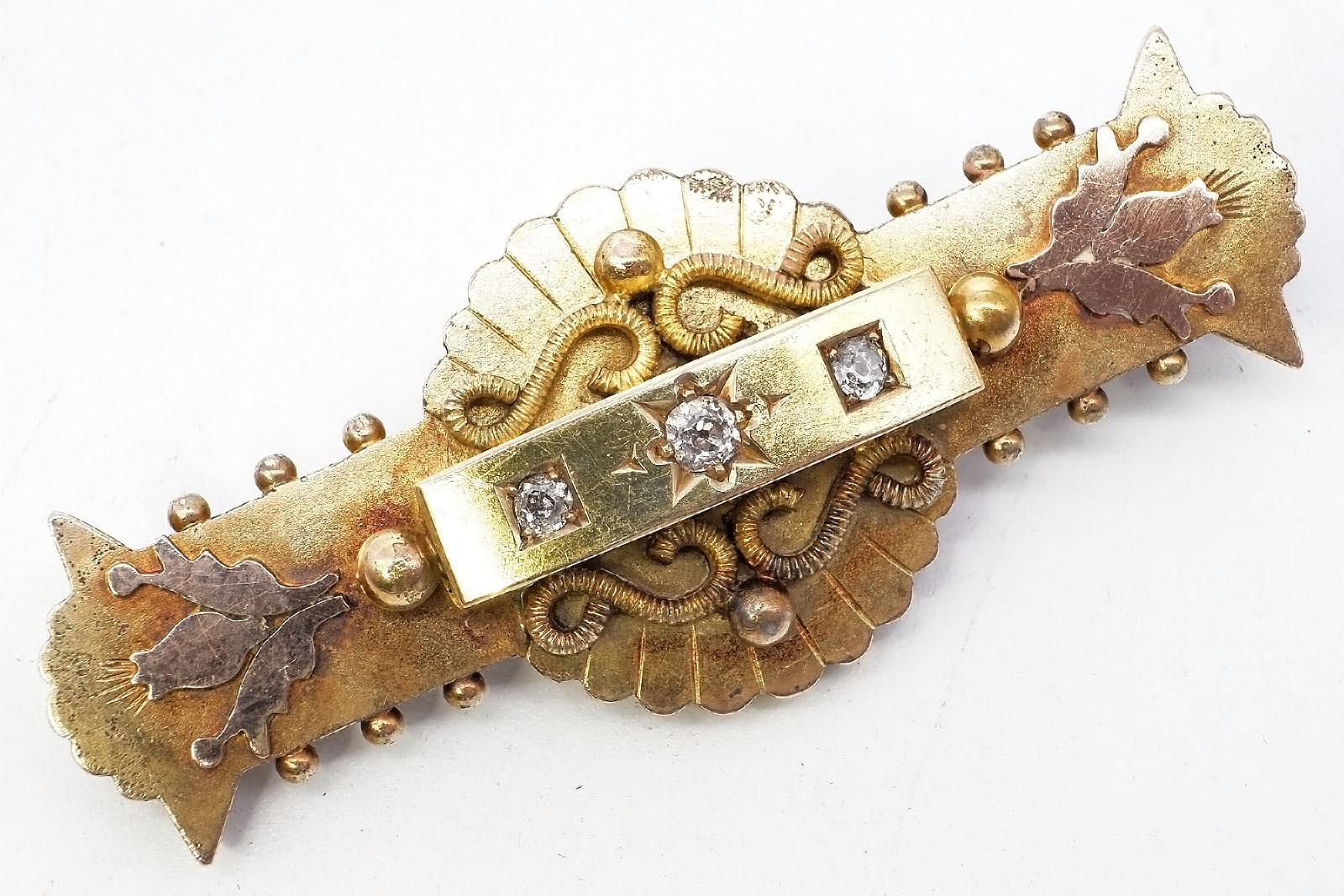 'Antique 15ct Yellow Gold Mourning Brooch with 15ct Pink Gold Thistles and Beads at each end, at centre Raised Box with Three Old Mine Cut Diamonds in Bead Setting, 9.3g'