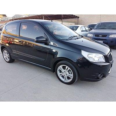 10/2010 Holden Barina  TK MY10 3d Hatchback Black 1.6L