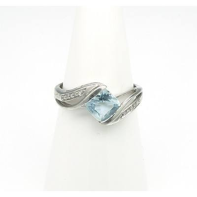 9ct White Gold Ring with Cushion Cut Pale Topaz and Ten Single Cut Diamonds