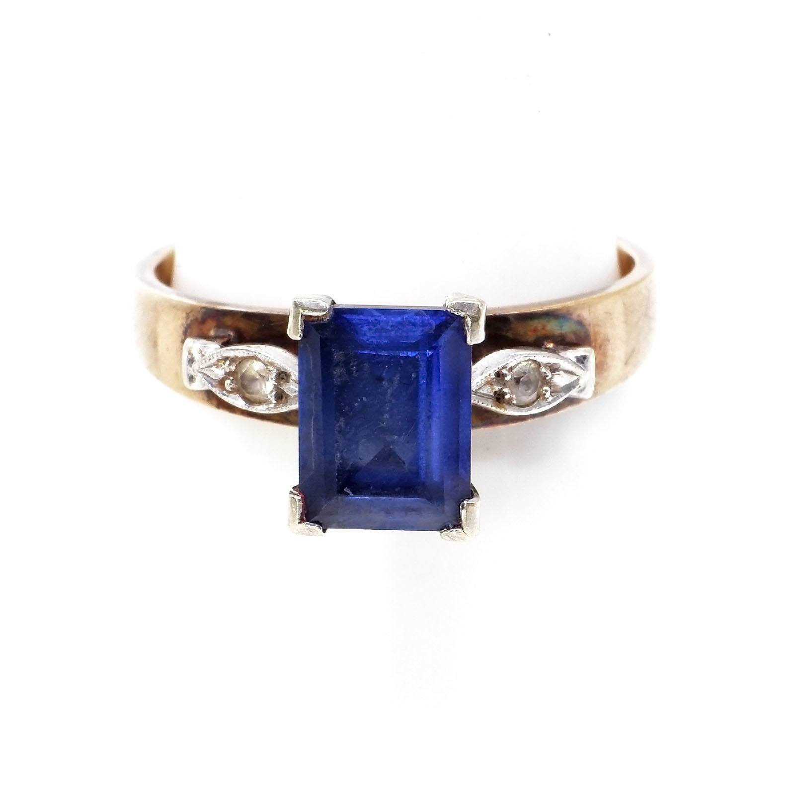 '14ct Yellow and White Gold Ring with Banquette Cut Blue Sapphire, Raised Leaf Shoulders with Small Single Cut Diamond, 3.1g'
