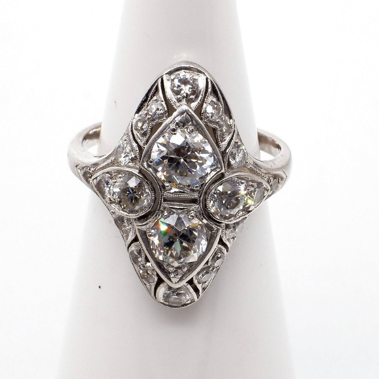 'Superb Art Deco Platinum Ring with Twelve Old European Cut Diamonds and Ten Old Single Cut Diamonds, All in Bead Setting in Separate Fields with Milgrain Edge in a Marquis Shaped Cluster'