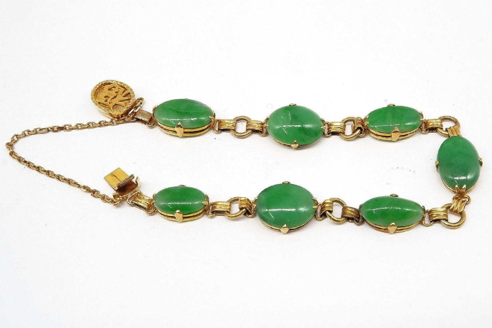 'Chinese 14ct Yellow Gold Bracelet with Seven Oval Cabochons of Apple Green Jadeite'