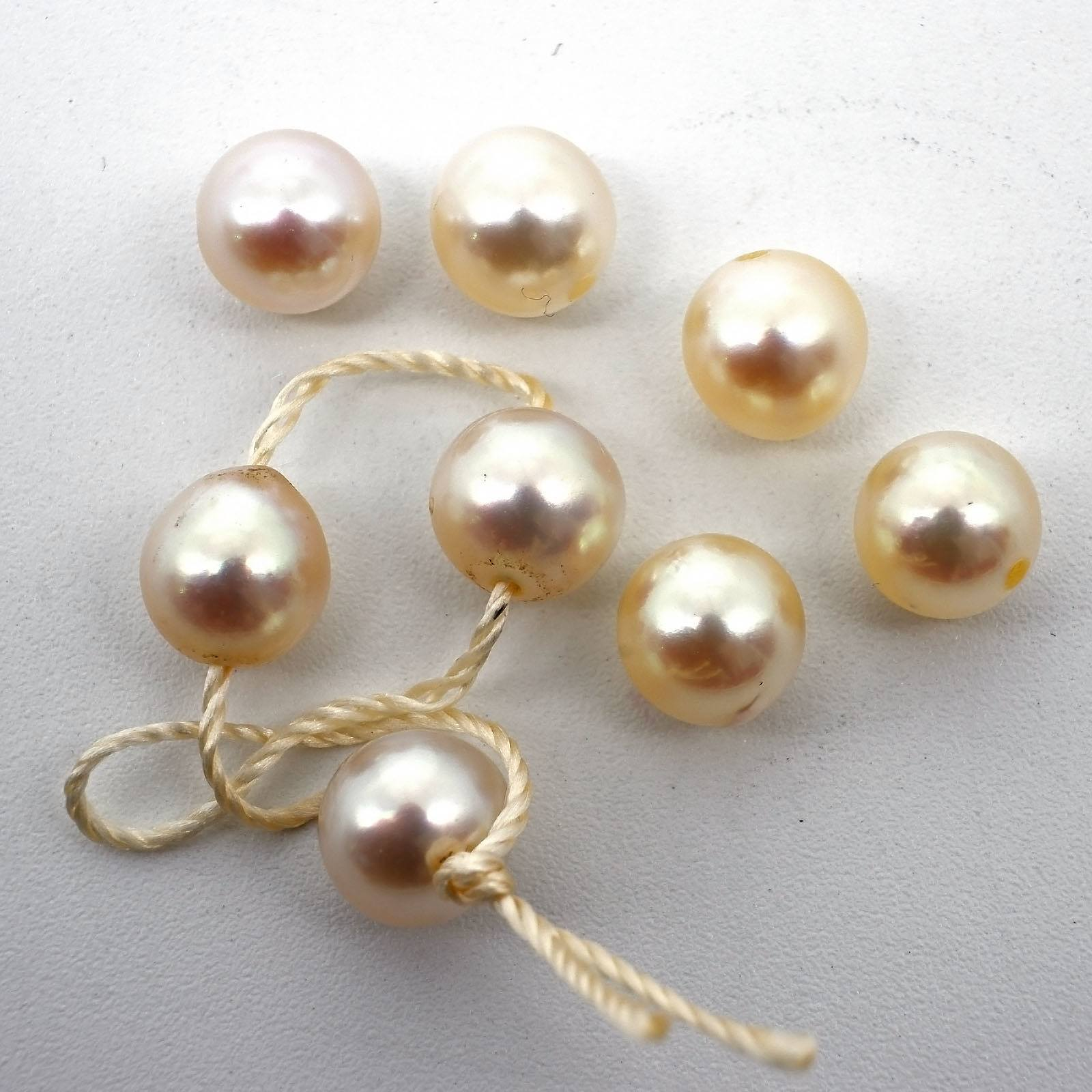 'Eight 6mm White Cultured Pearls'