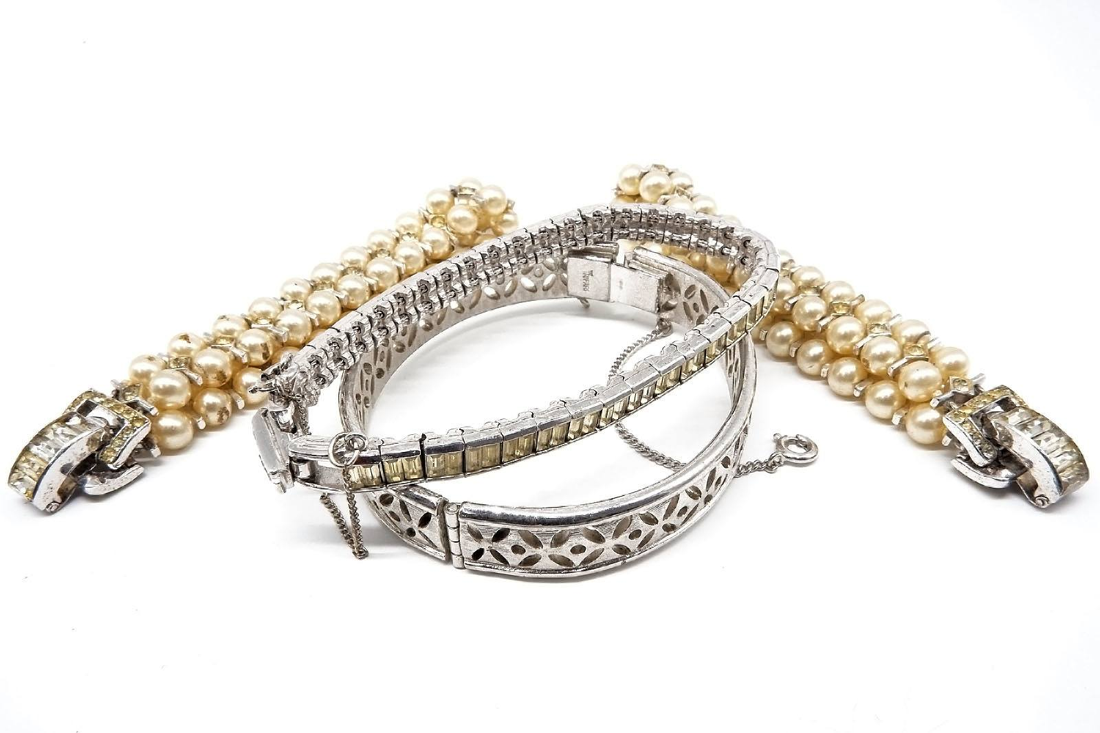 'Pair of Faux Pearl Bracelets and Two Others'