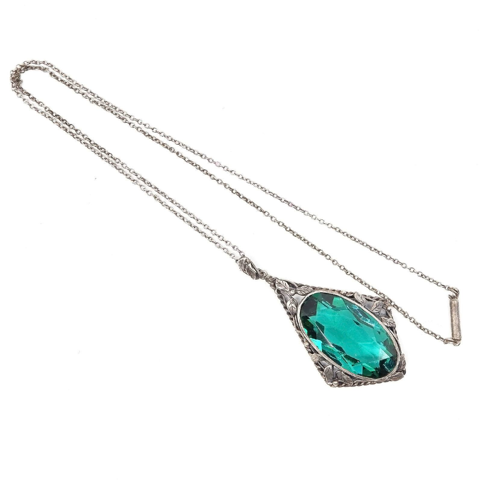 'Antique Silver Pendant with Large Oval Facetted Green Paste Bezel Set in Floral Design on a Silver Chain'