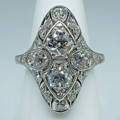 Superb Art Deco Platinum Ring with Twelve Old European Cut Diamonds and Ten Old Single Cut Diamonds, All in Bead Setting in Separate Fields with Milgrain Edge in a Marquis Shaped Cluster