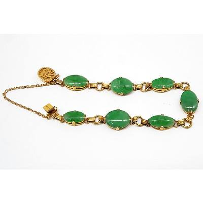 Chinese 14ct Yellow Gold Bracelet with Seven Oval Cabochons of Apple Green Jadeite