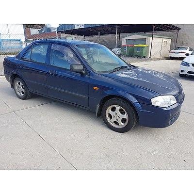 10/2000 Mazda 323 Protege Shades  4d Sedan Blue 1.6L