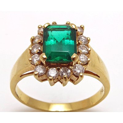 18ct Gold Synthetic Emerald & Diamond Halo Ring
