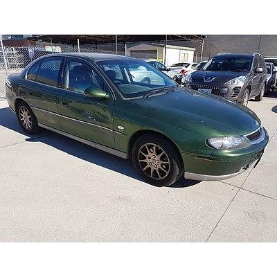 6/2002 Holden Calais  VXII 4d Sedan Green 3.8L