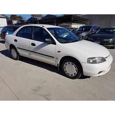 4/1996 Ford Laser LXi KJ 4d Sedan White 1.8L