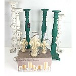 Six Large Candlesticks and a Group of Scented and Unscented Candles