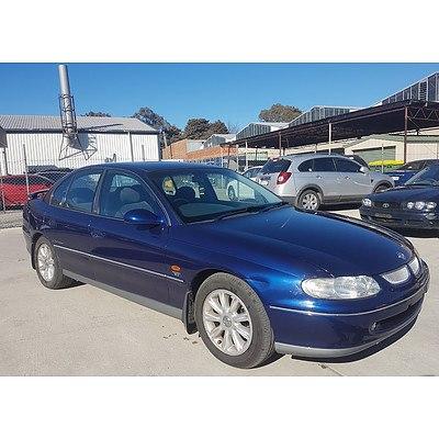 5/1999 Holden Calais  VT 4d Sedan Blue 3.8L