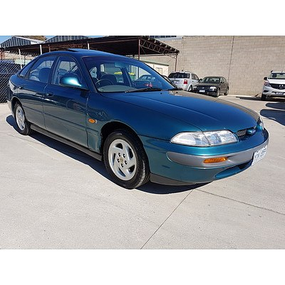 7/1993 Ford Telstar TX5 GHIA (4ws) AX 5d Hatchback Green 2.5L
