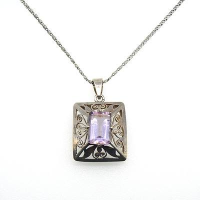 Emerald Cut Pale Amethyst in Four Claws Above a Fancy Pierced Box Pendant on a Silver Scroll Chain