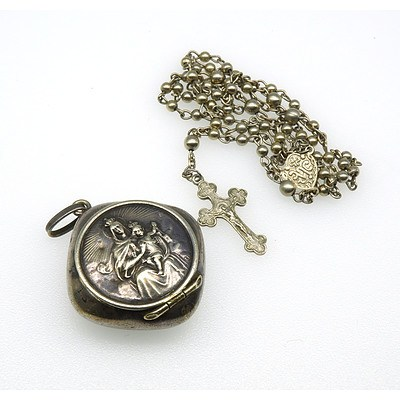 Silver Coloured Metal Rosary Beads in a Case