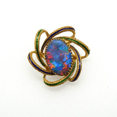 18ct Yellow Gold Black Opal Doublet Brooch with Excellent 'Play of Colour' and Six Gold Wire Swirls with Blue and Green Enamelling Forming a Frame