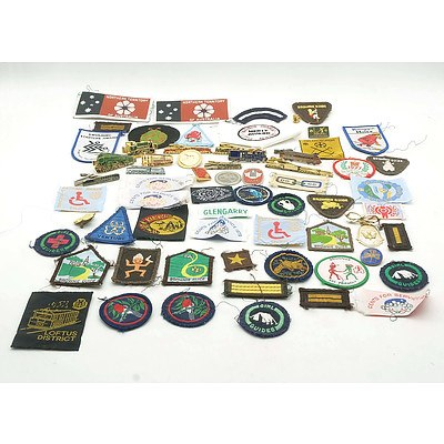 A Group of Assorted Patches, Metal Badges and Train Themed Tie Pins