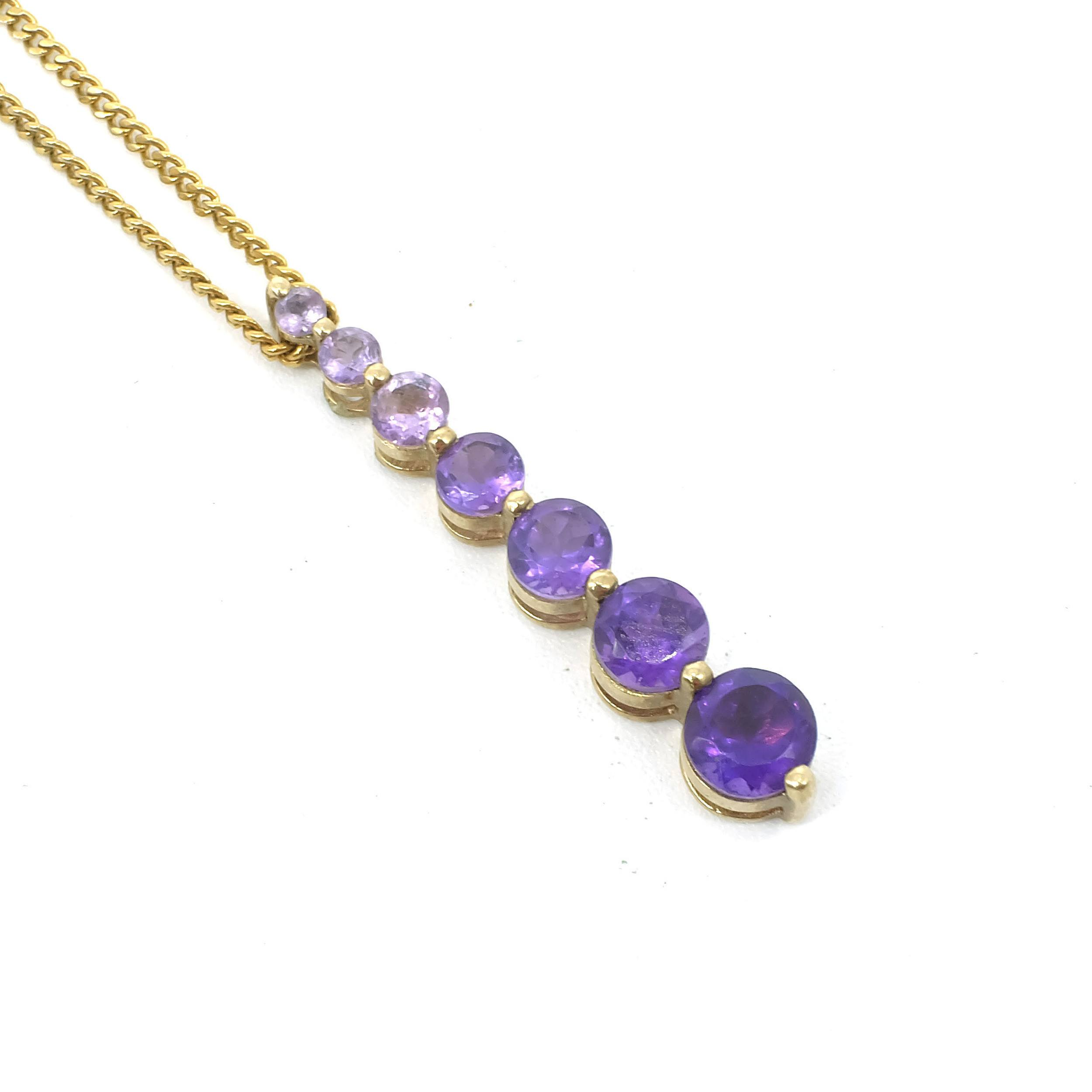 '9ct Yellow Gold Pendant with a Drop of Graduated Amethysts in Colour and Size on a Gold Plated Chain, 3g'