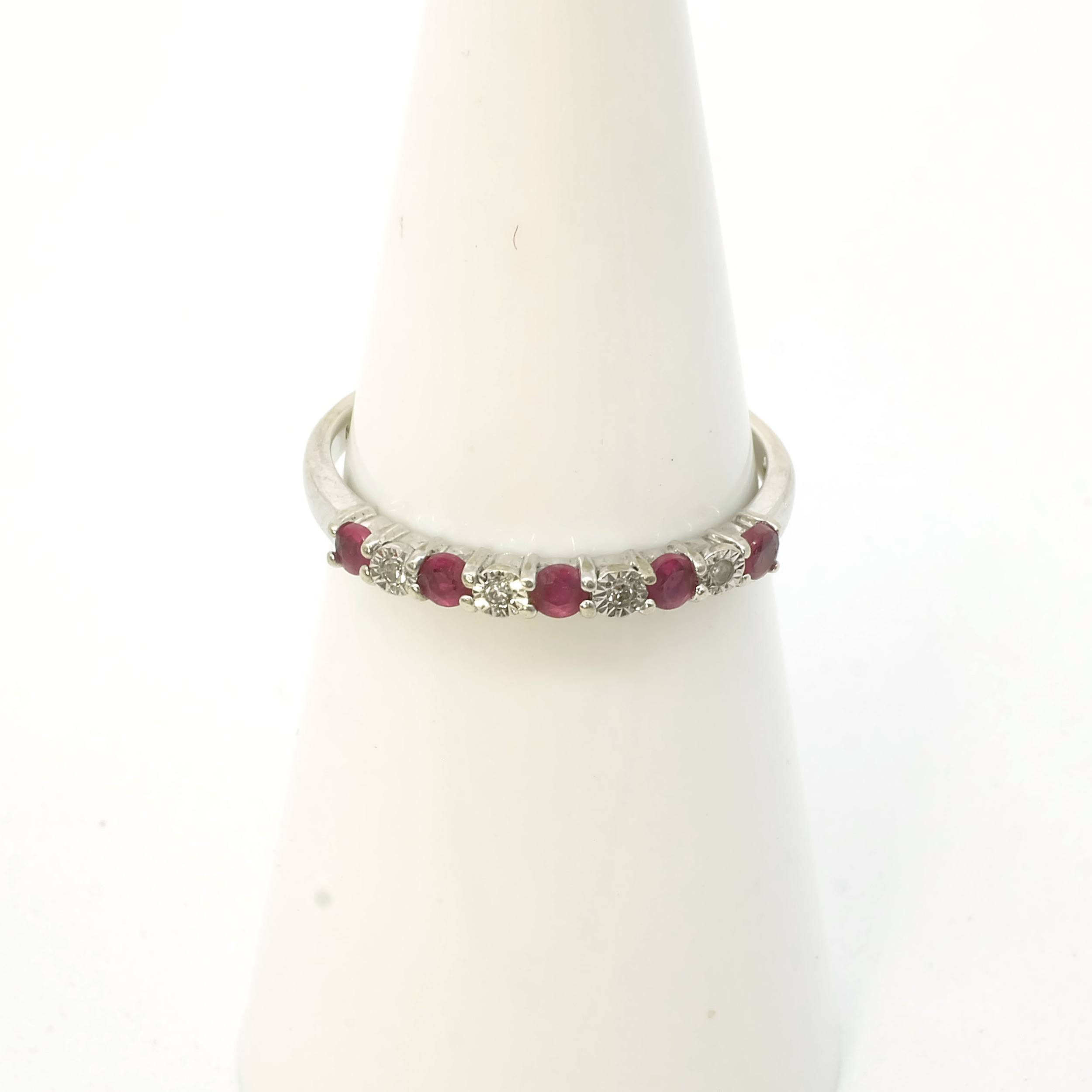 '10ct White Gold with Five Round Facetted Rubies and Four Round Single Cut Diamonds, 1.2g'