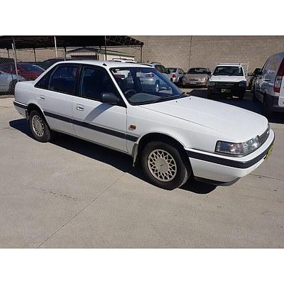6/1991 Mazda 626   4d Sedan White 2.2L