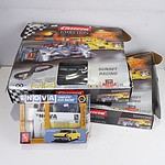 Two Carrera Mega Evolution Racing Tracks and a 1:25 Scale Slot Racing Kit