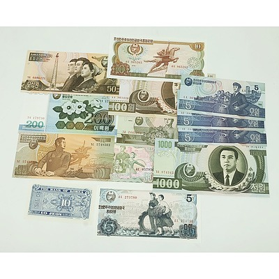 Group of North Korean Banknotes, Including 2002 100 Won, 2005 200 Won