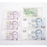 Group of Singapore Dollars, Including Two $50, One $5 and Three $2