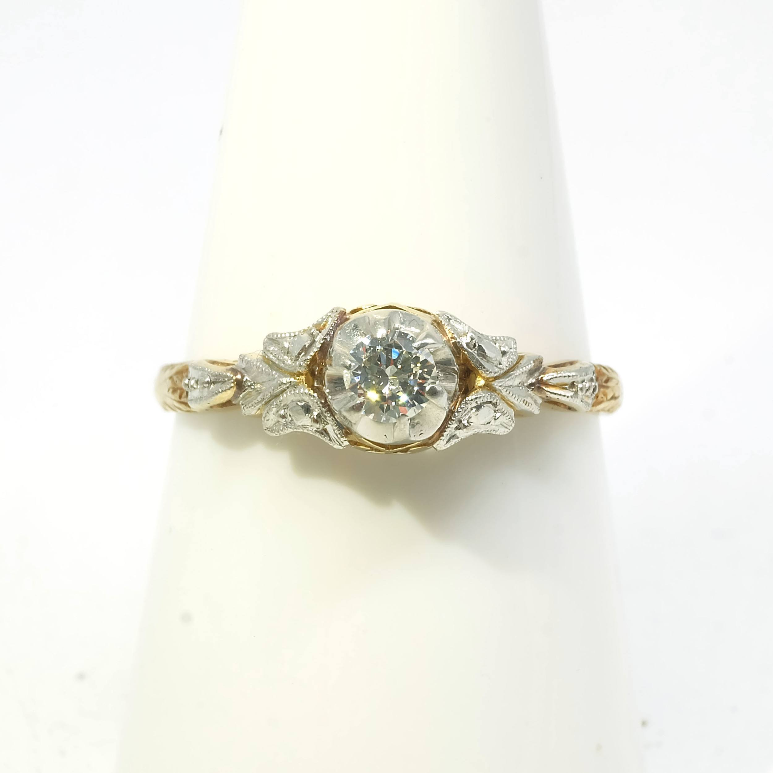 '18ct Yellow and White Gold Diamond and Solitaire Ring, with Round Brilliant Cut Diamond in Six Claw Illusion Setting with Fancy Engraved Shoulders'