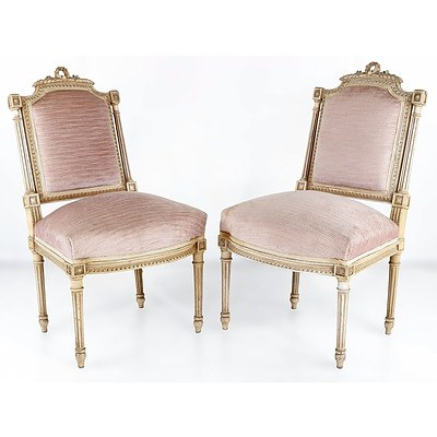 Pair of French Louis XVI Style Carved Beech and Ivory Painted Salon Chairs, Mid 20th Century