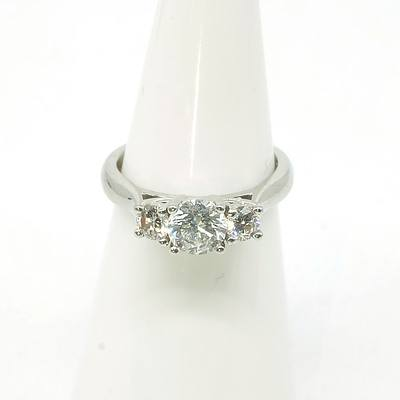 Platinum (950) Ring with Three Round Brilliant Cut Diamonds, 1x 0.50ct and 2x 0.12ct (F/g Si2)