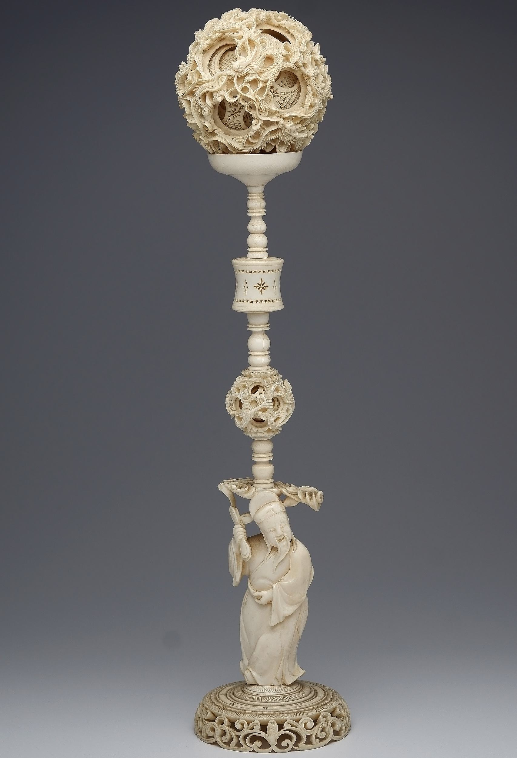 'Exceptional Large Antique Chinese Carved Ivory Dragon Puzzle Ball on an Immortal and Lantern Form Stand, Late 19th/Early 20th Century'