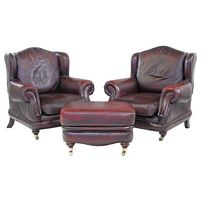Pair of British Made Thomas Lloyd Red Leather 'Consort' Wingback Armchairs and Matching Ottoman
