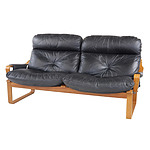 Tessa Black Leather Upholstered Two Seater Lounge Designed by Fred Lowen