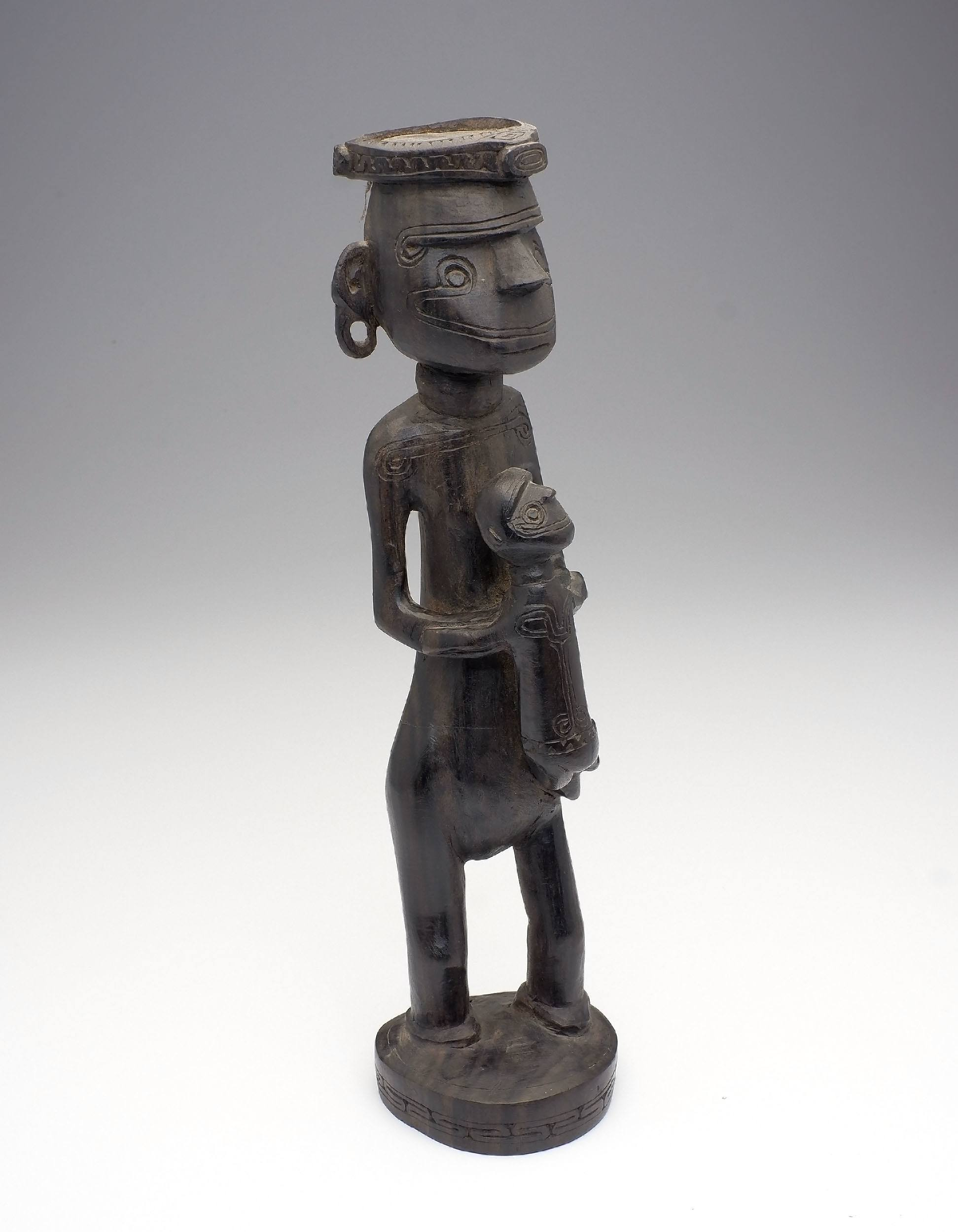 'Massim People, Carved Ebony Maternity Figure, Trobriand Islands PNG Early to Mid 20th Century'