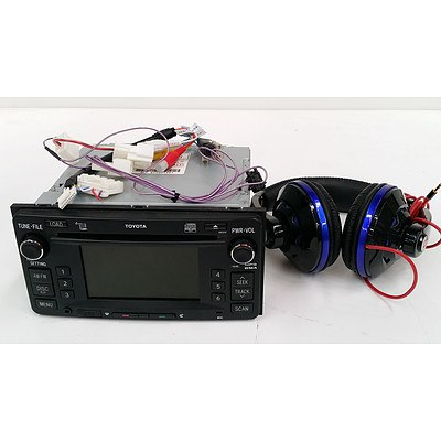 Toyota Landcruiser 200 Series Car Stereo and Set of Headphones