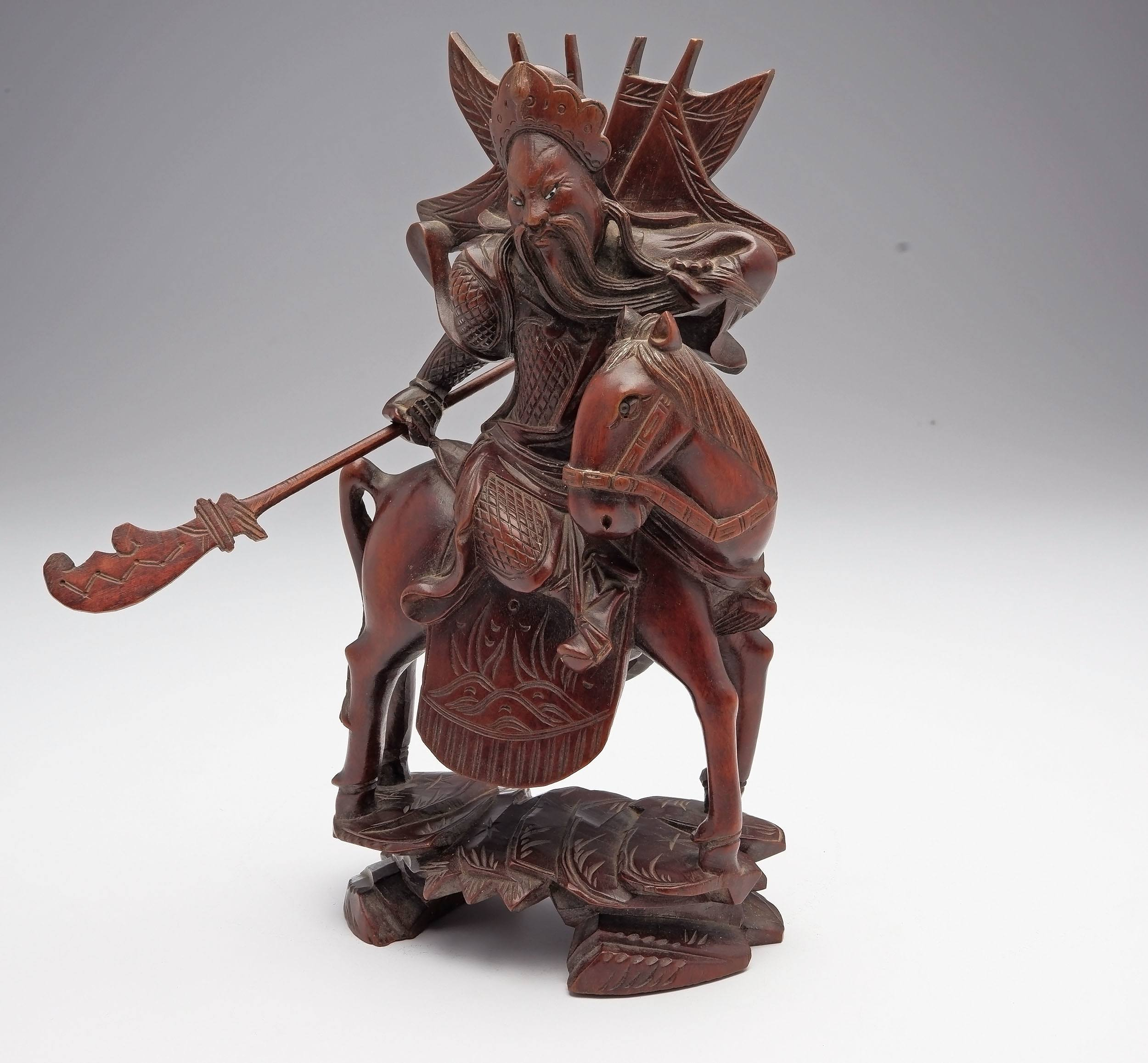'Chinese Carved Hardwood Model of A Warrior, Early to Mid 20th Century'