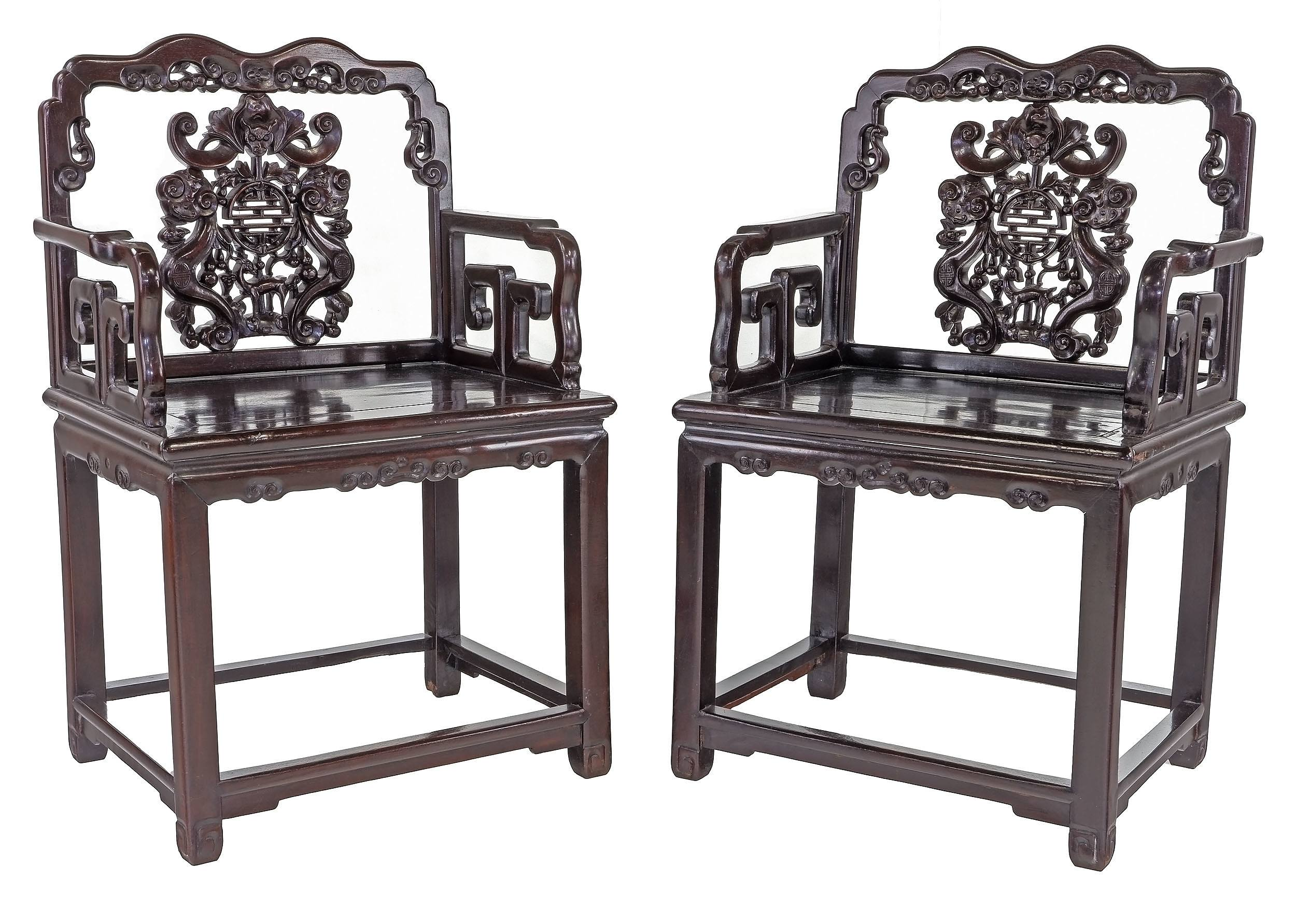 'Pair of Antique Chinese Stained Hardwood Armchairs Carved with Bats and Shou Symbols with Companion Side Table'