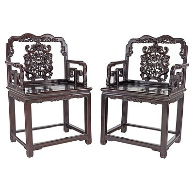 Pair of Antique Chinese Stained Hardwood Armchairs Carved with Bats and Shou Symbols with Companion Side Table